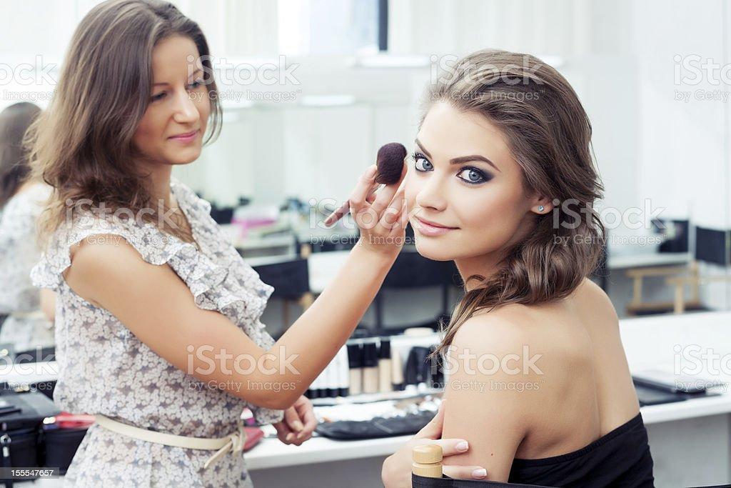 MUA applying powder stock photo