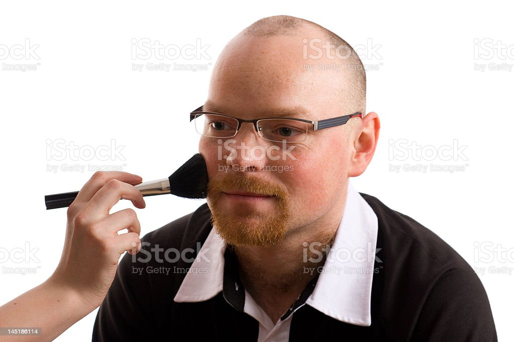 applying powder with brush on male adult model royalty-free stock photo