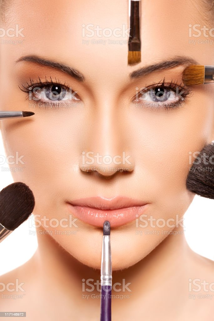 Applying professional make up stock photo