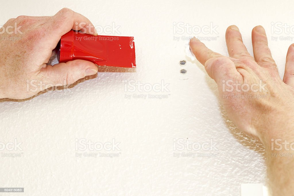 Applying Spackling stock photo