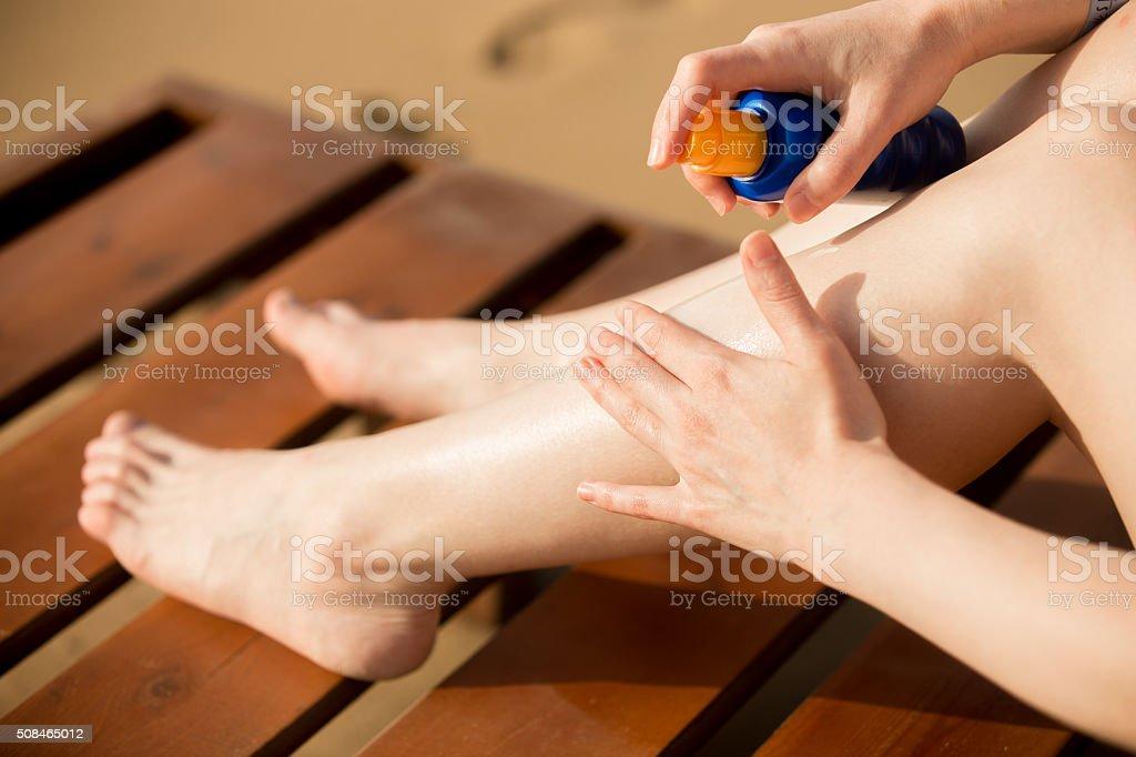 Applying sunscreen stock photo