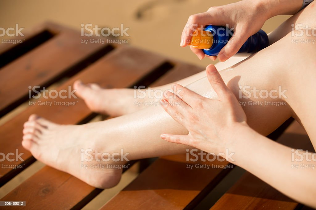 Applying sunscreen stock photo