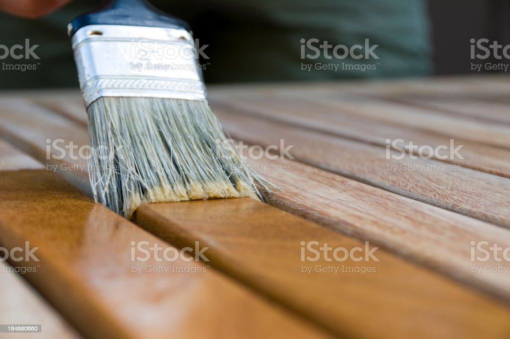 Applying Wood Stain stock photo