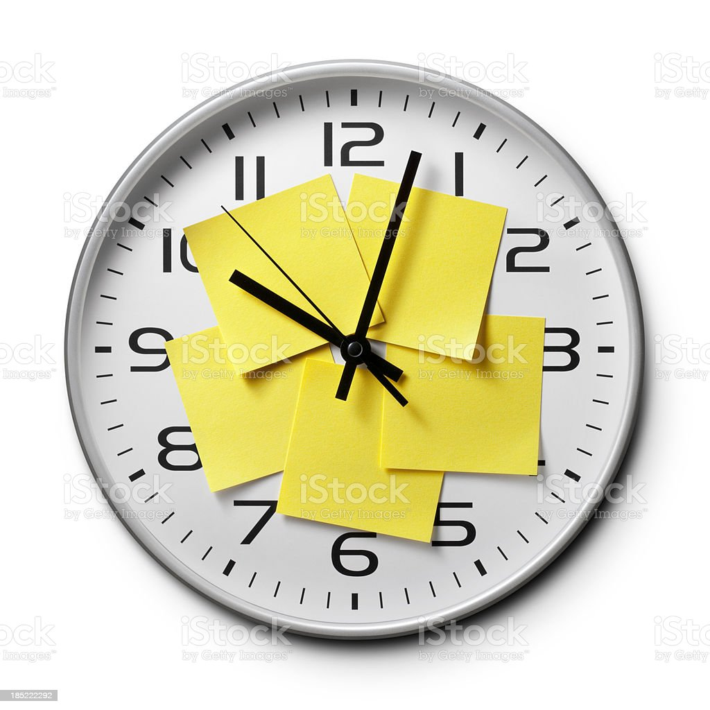 Appointment reminders. Clock with yellow sticky notes. royalty-free stock photo