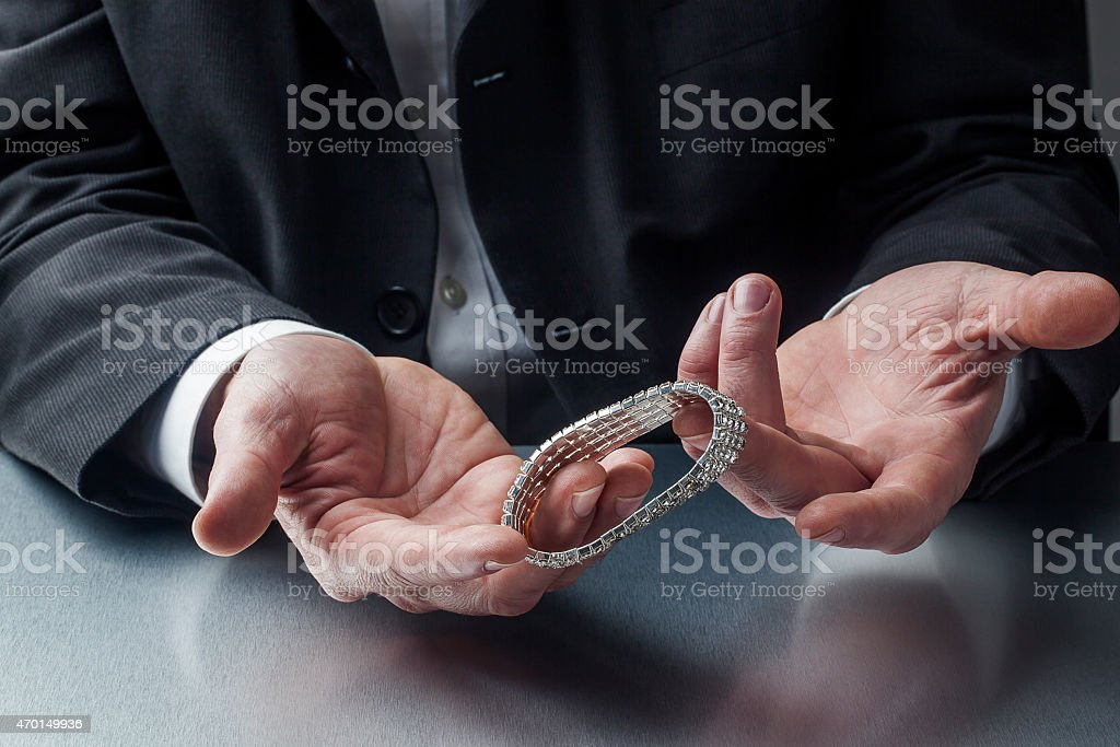 appraising jewelry for work stock photo