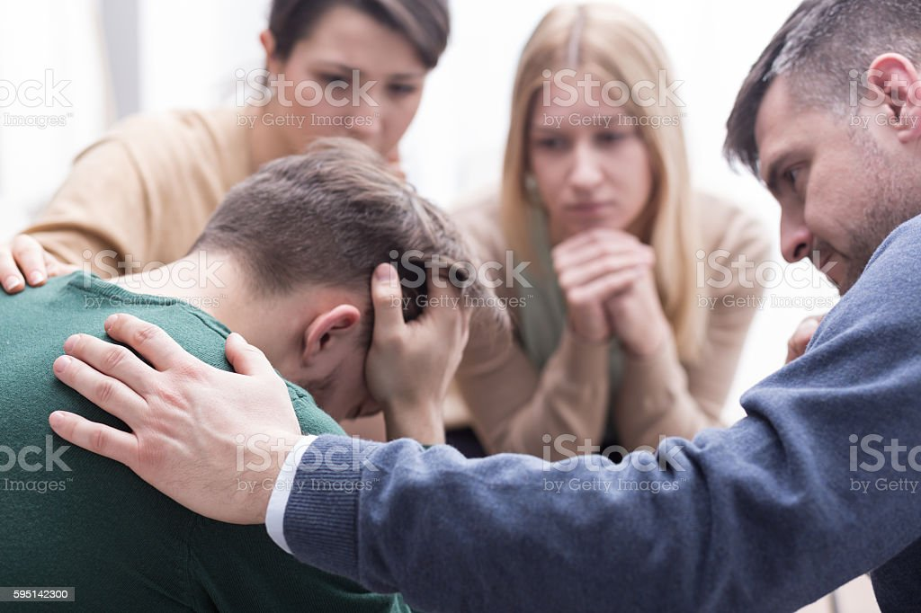 Appreciating the helping hand of his friends stock photo