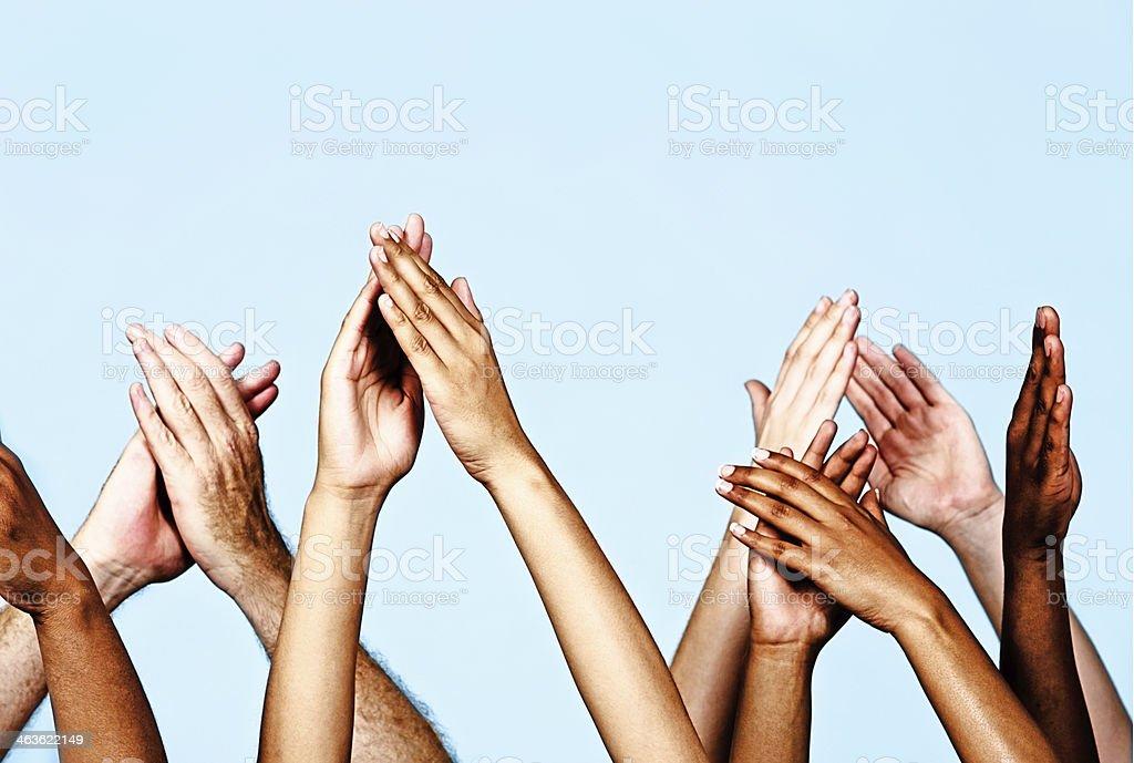 Appreciative hands applaud enthusiastically stock photo