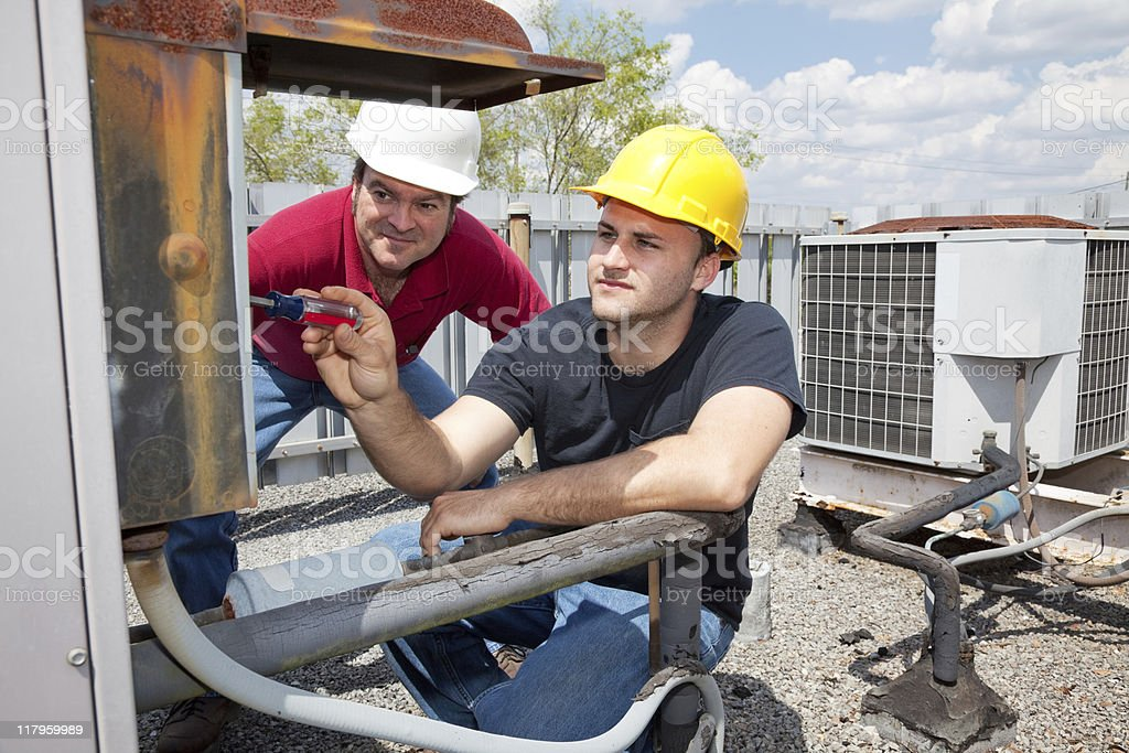 Apprentice Air Conditioning Repairman royalty-free stock photo