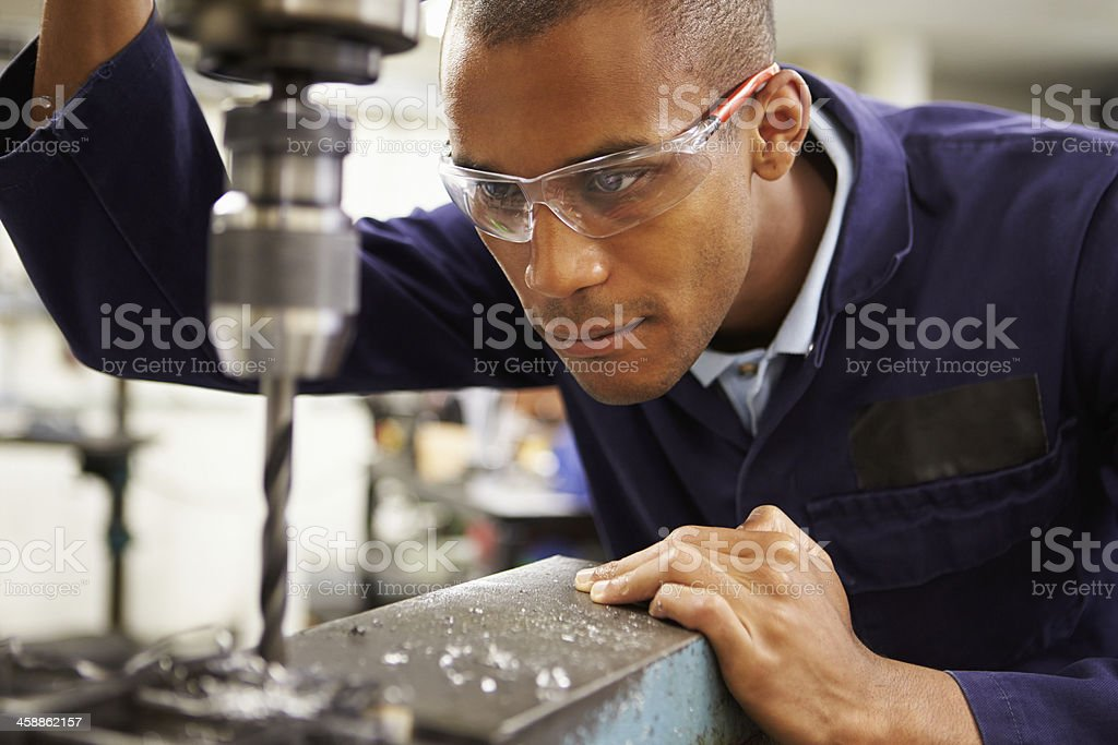 Apprentice Engineer Using Milling Machine stock photo