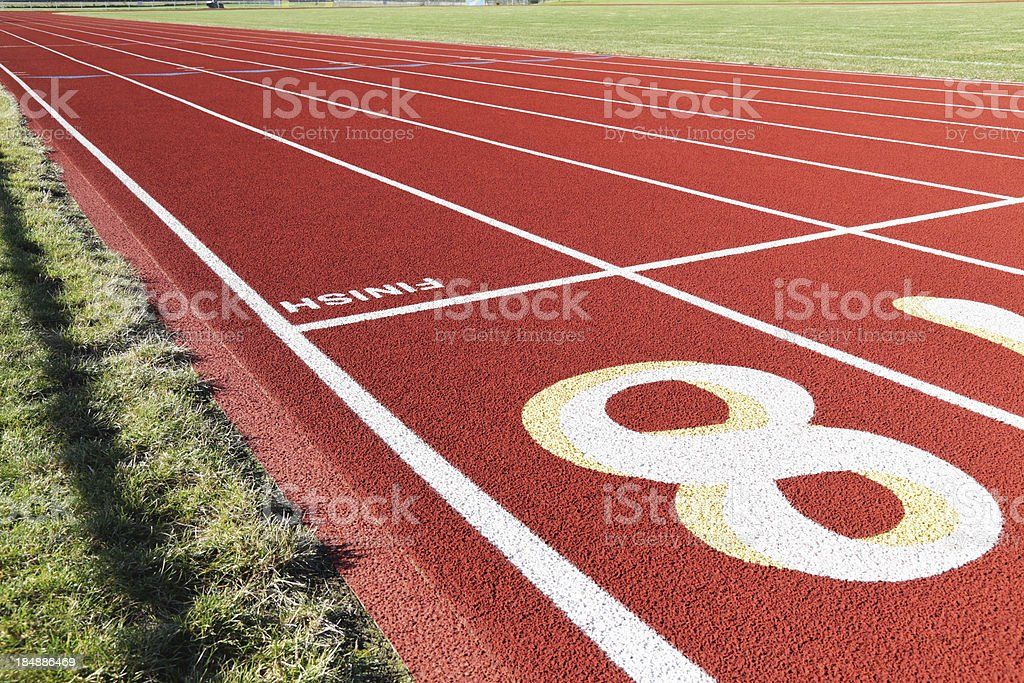 Approach to the Finish Line on Red Running Race Track royalty-free stock photo