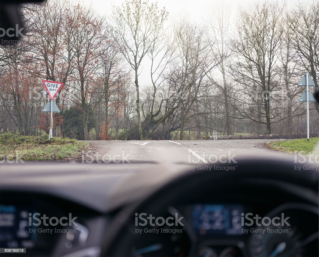 Approaching a Give Way sign at a UK T-Junction stock photo