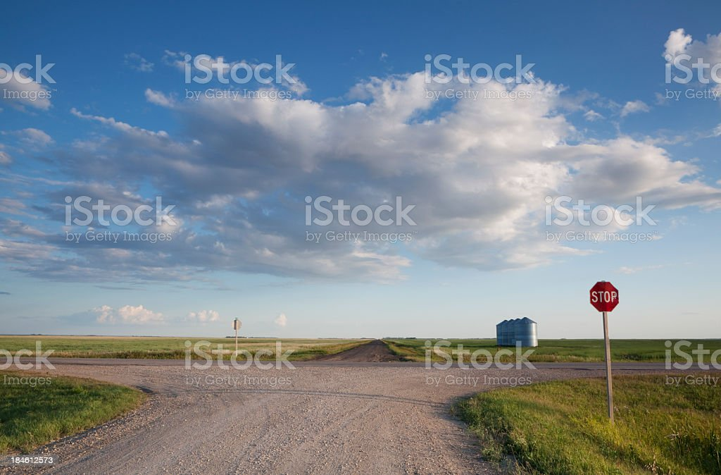 Approaching a stop sign on a dirt road on a clear day royalty-free stock photo