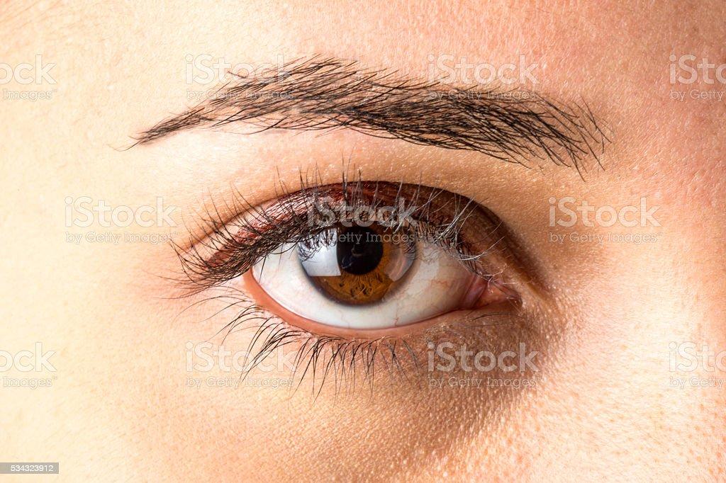 Approaching brown eye woman stock photo