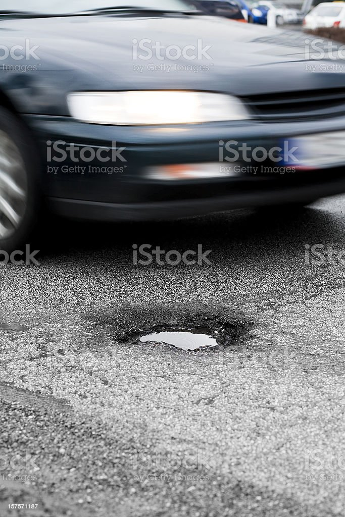 Approaching car, pothole royalty-free stock photo