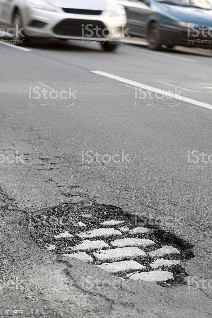 Approaching cars, pothole royalty-free stock photo