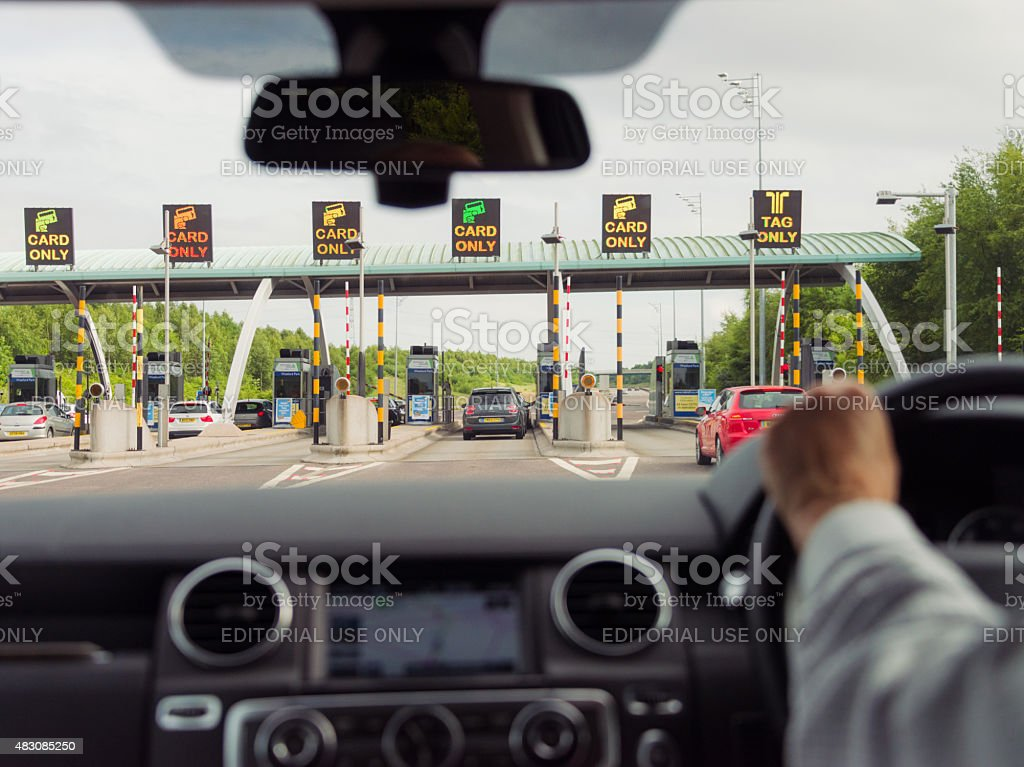 Approaching motorway toll station stock photo