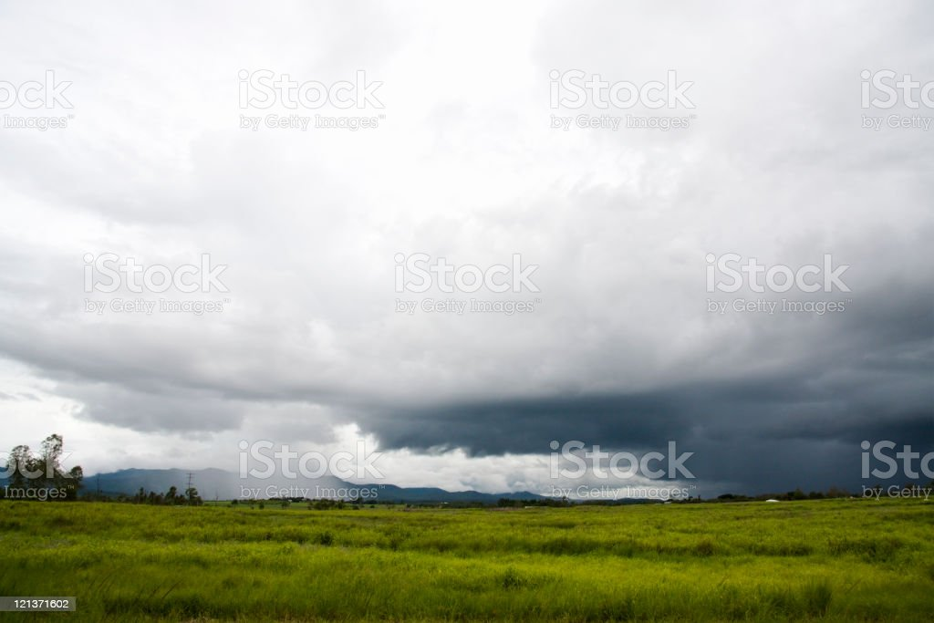 Approaching Rain over a green field in Tropical North Queensland royalty-free stock photo