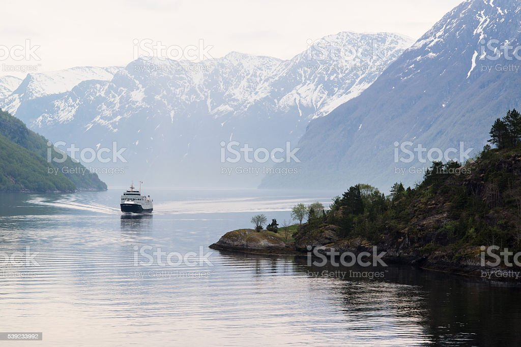 Approaching Ship on the Geirangerfjord, Norway stock photo