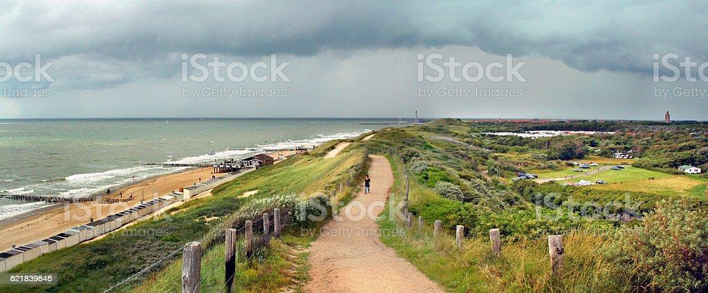 Approaching thunderstorm and dutch coastal flood defense stock photo