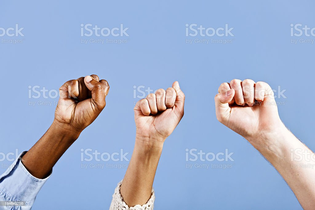Approval or rebellion as three clenched fists punch the air royalty-free stock photo
