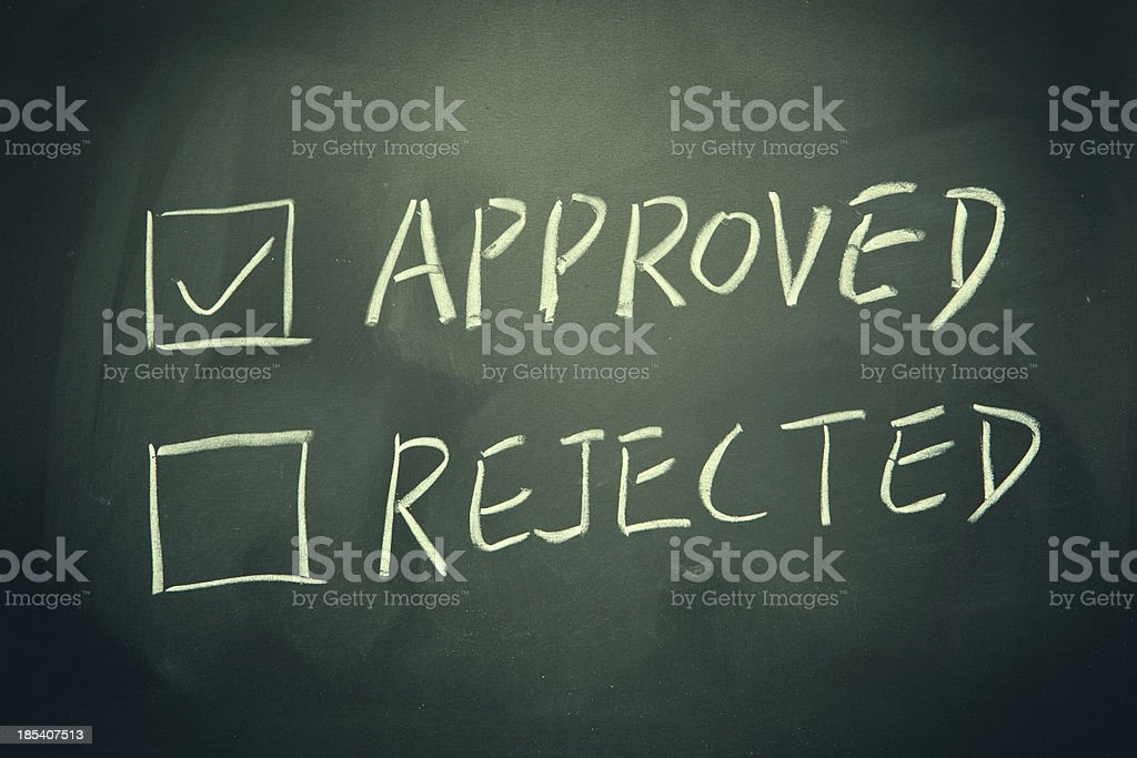 Approved and Rejected check boxes written on a blackboard. royalty-free stock photo