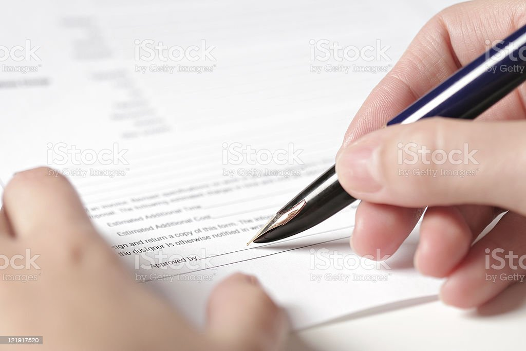 approved by .... signing papers royalty-free stock photo