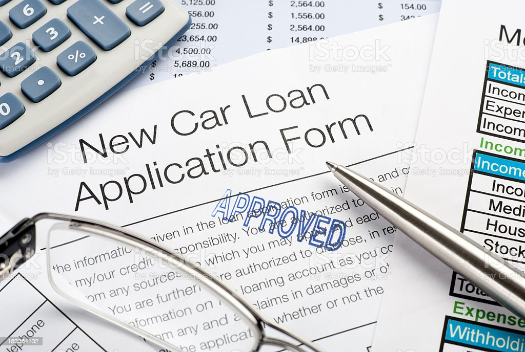 Approved Car loan application Form with pen, calculator stock photo