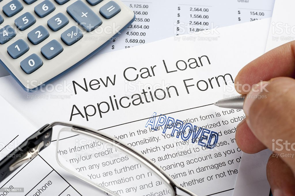 Approved Car loan application Form with pen, calculator, writing stock photo