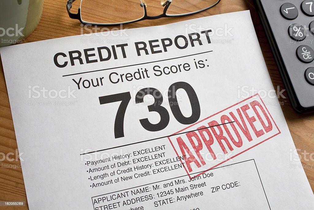 Approved Credit Score form on a desk. stock photo