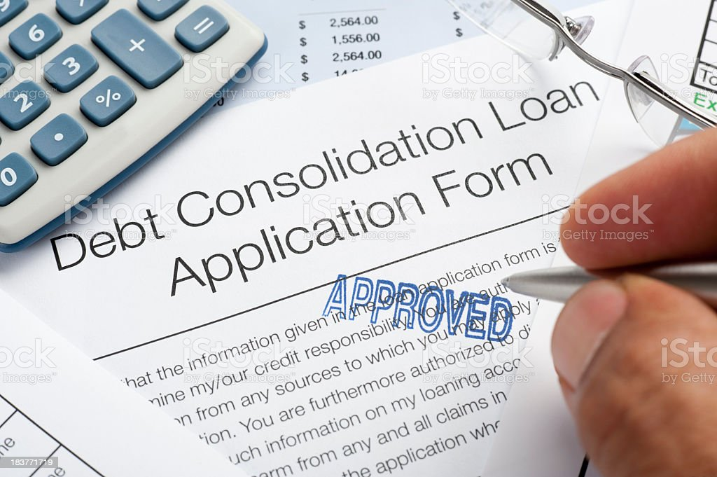 Approved Debt Consolidation Loan Application Form with pen, calc stock photo