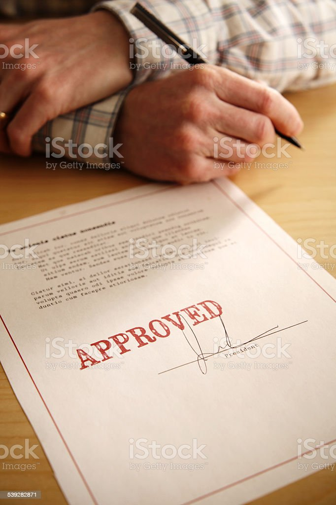 Approved Document or Signing a Bill Into Law stock photo