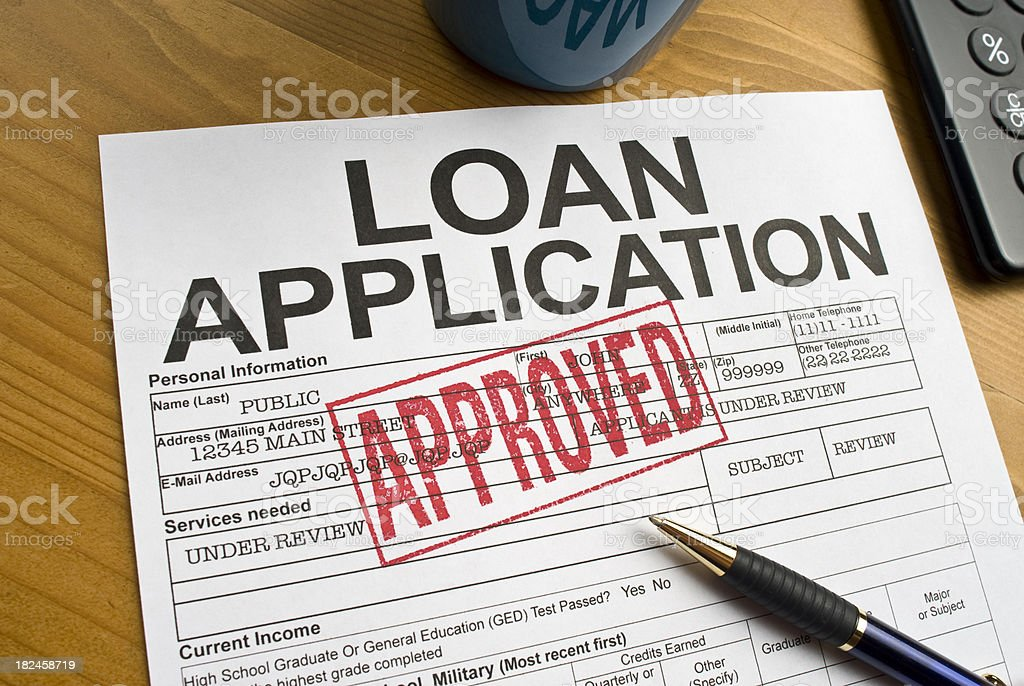Approved Loan Application on a desktop stock photo