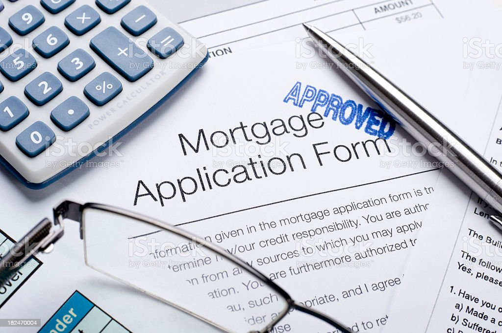 Approved Mortgage application form with a calculator and pen stock photo
