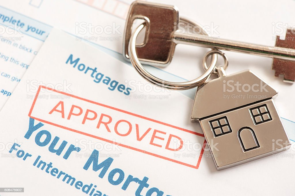 Approved mortgage loan agreement stock photo