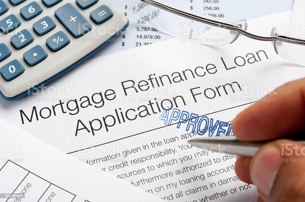 Approved Mortgage Refinance Application Form with pen, calculato stock photo