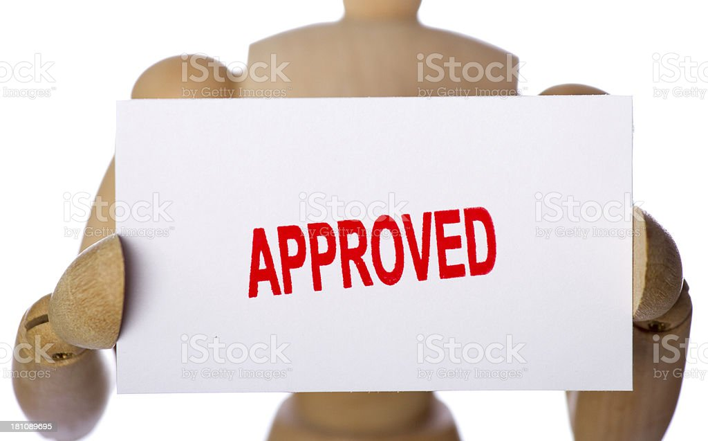 Approved sign held by wooden mannequin royalty-free stock photo