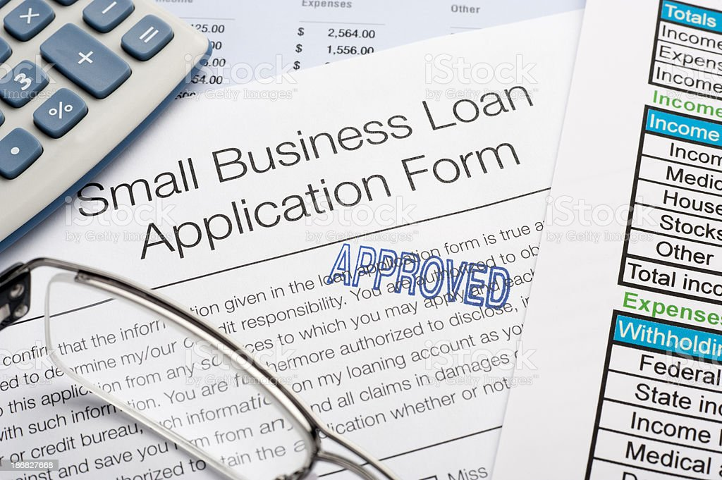 Approved Small Business loan application Form with pen, calcula stock photo