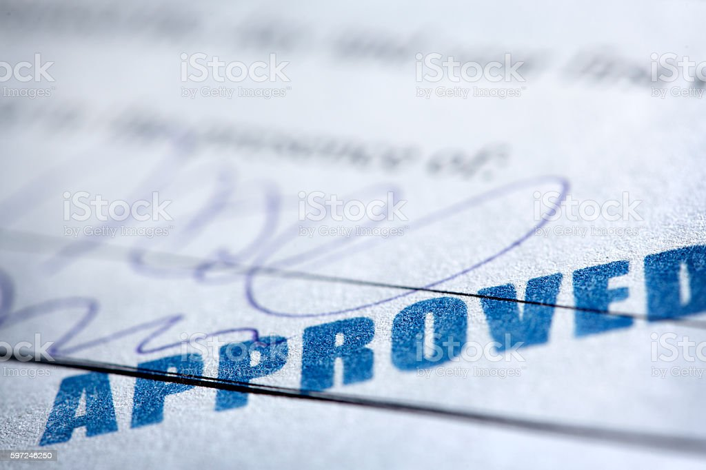 Approved Stamp On Signed Document stock photo