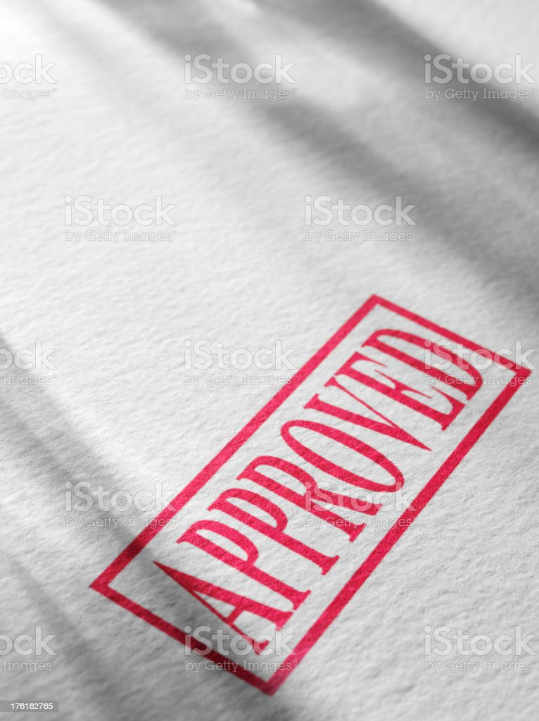 Approved Stamp on Textured Paper royalty-free stock photo