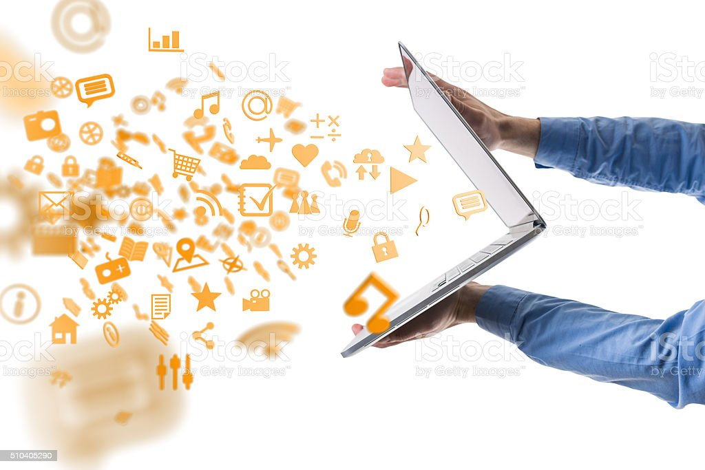 Apps, media and other information flying out of a notebook stock photo