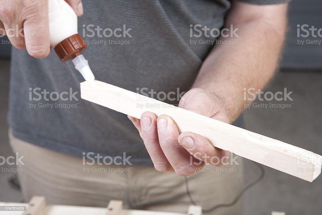 Appyling glue on wood stock photo