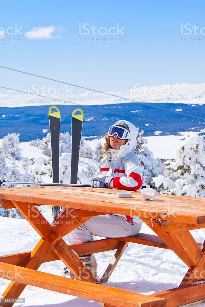 Apres ski. Beautiful skier waiting for order in cafe royalty-free stock photo