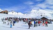 Apres ski party on ski slopes bar restaurant in Alps
