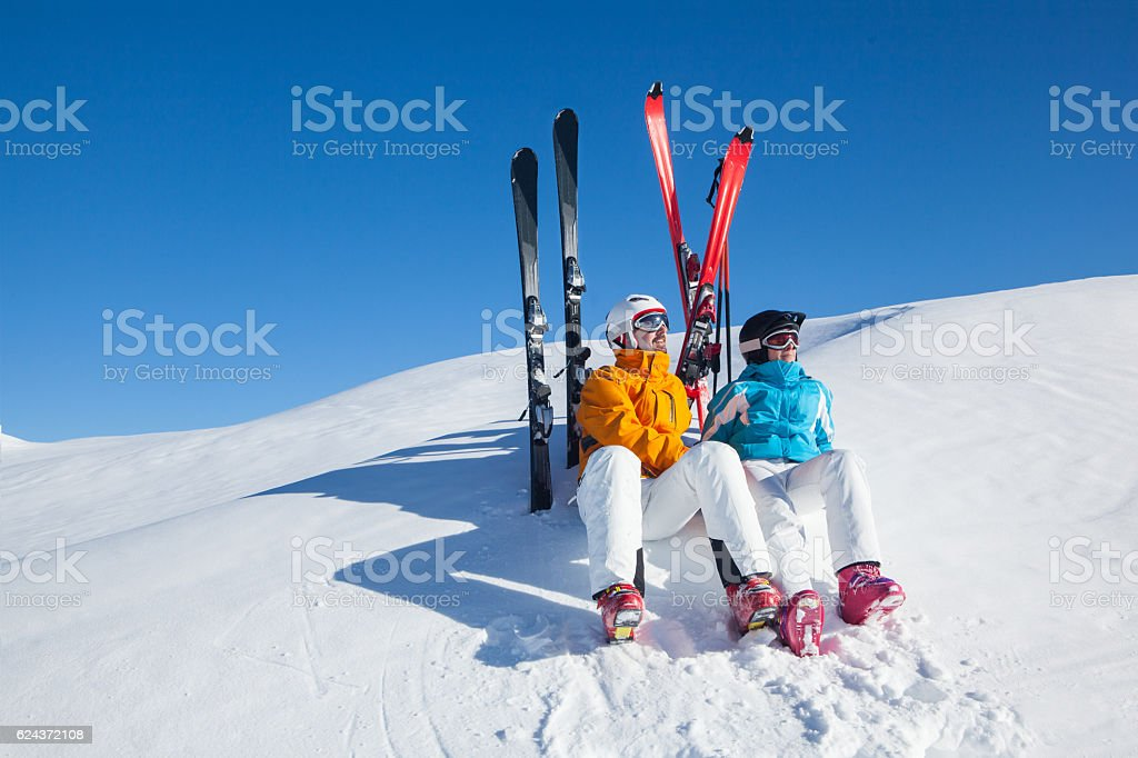 apres ski relaxing skiers stock photo