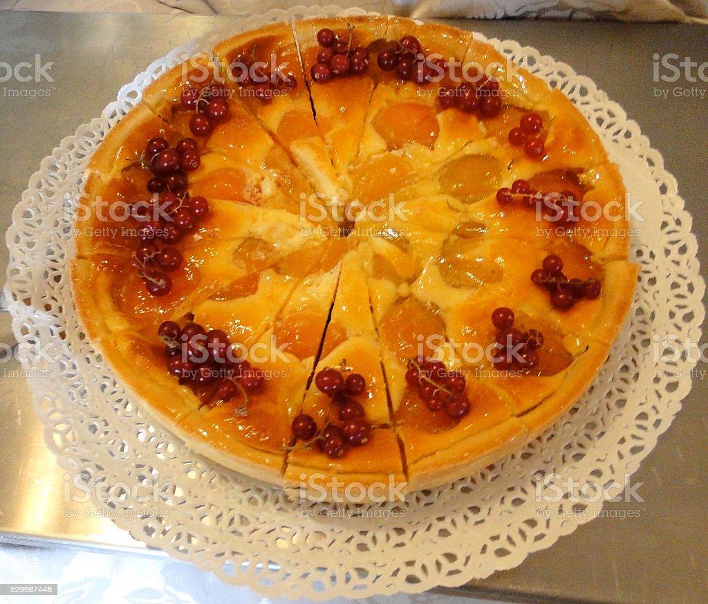 Apricot and Custard Tart on Ornate Paper Doily stock photo