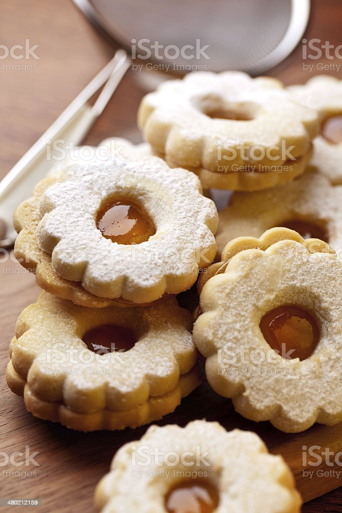apricot jam cookies just covered with powdered sugar stock photo