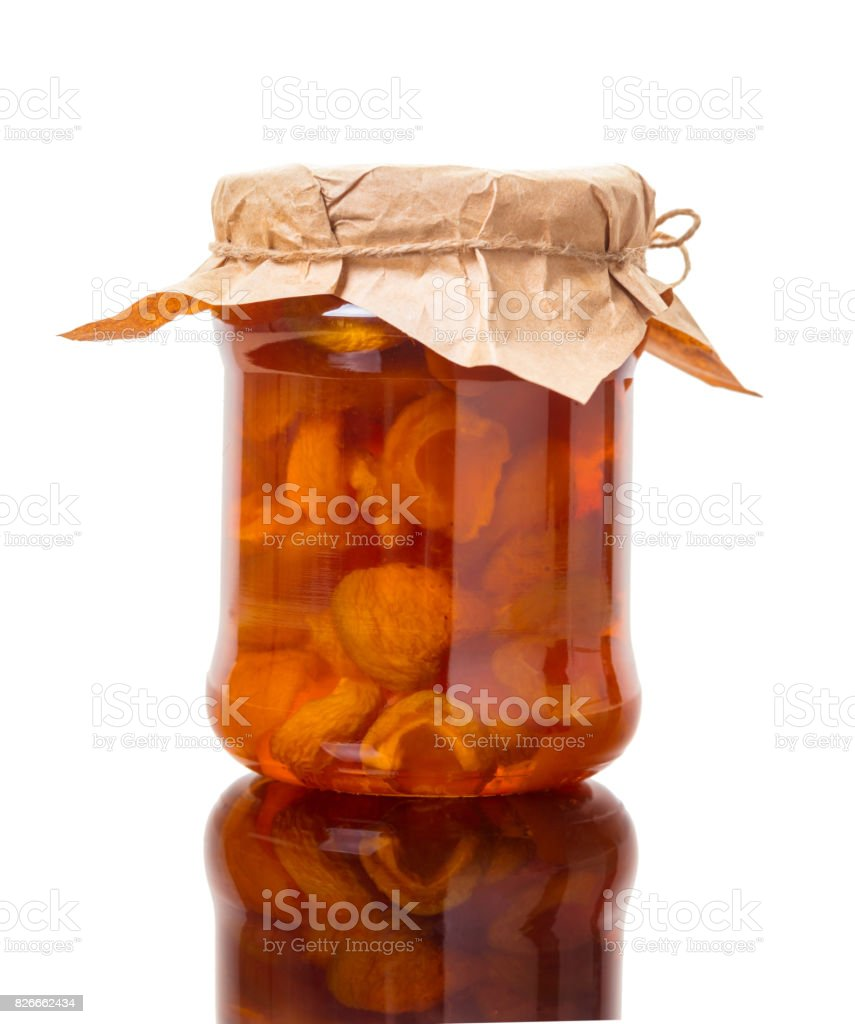 Apricot jam in a jar stock photo