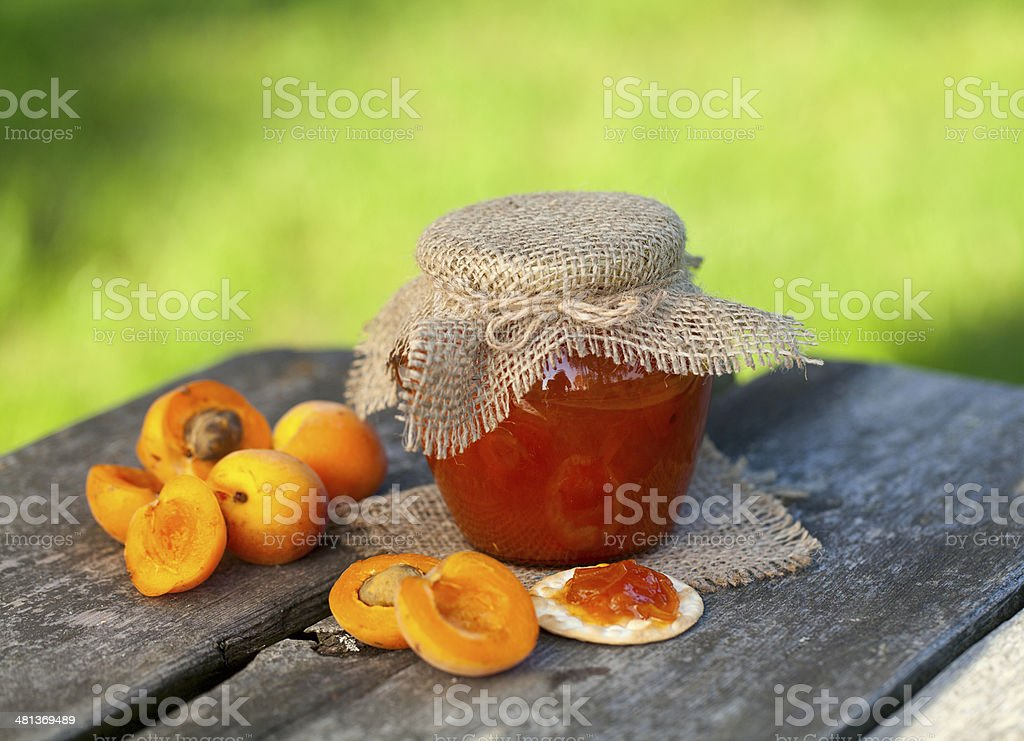 apricot jam on a wooden bowl stock photo