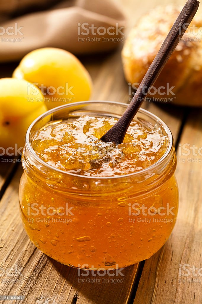 Apricot jam on rustic wood table stock photo