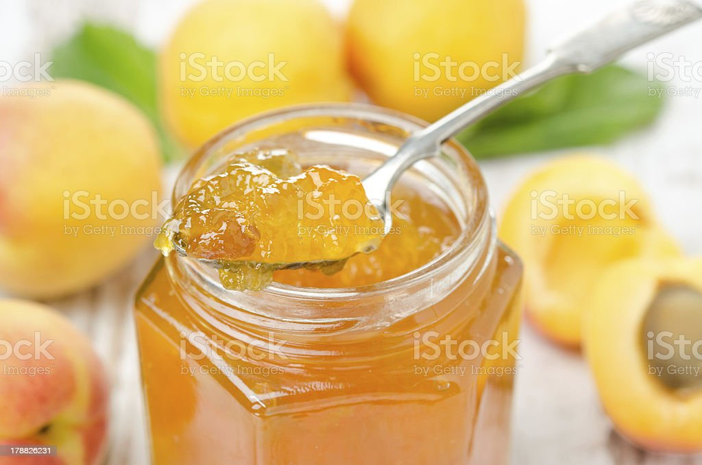 apricot marmalade in a spoon close-up royalty-free stock photo